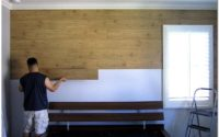 Процесс укладки ламината на стену